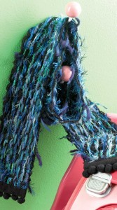8. To finish, sew the pom-pom edging to the cotton-knit trim, along both the top and bottom edge.