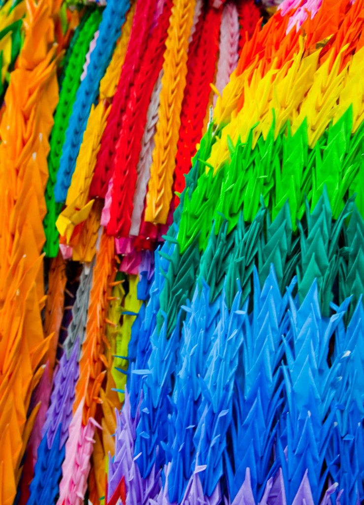 """""""Different coloured papers are used to create brilliant effects on these long strings of paper cranes"""