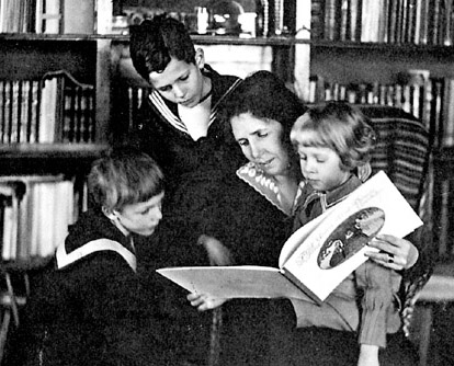 Photograph of Elsa Beskow, Swedish children's author and illustrator, reading a picture book with children